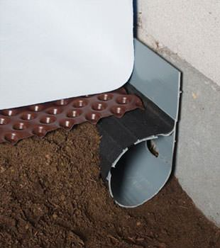 Closeup of a crawl space drainage system installed in Farmingdale