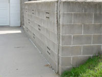A retaining wall separating from the adjoining walls in Nassau County