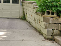 a failing retaining wall around a driveway in Brookhaven