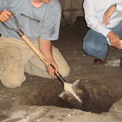 Digging a hole for the engineered fill used in a crawl space support system installation in Bay Shore