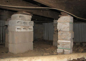 crawl space repairs done with concrete cinder blocks and wood shims in a Manhasset home