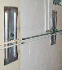 A foundation wall anchor system used to repair a basement wall in Manhasset