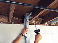 Straightening a foundation wall with the PowerBrace™ i-beam system in a Massapequa home.