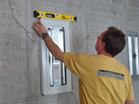 Positioning a wall plate cover on a foundation wall in Bay Shore.