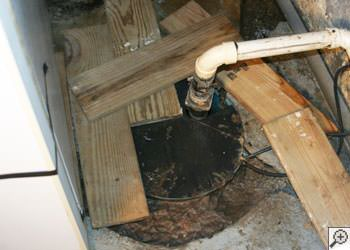 An ugly, clogged sump pump system in Huntington, Long Island
