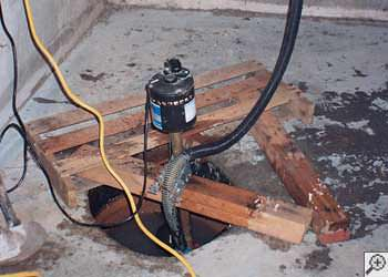 A Great Neck sump pump system that failed and lead to a basement flood.