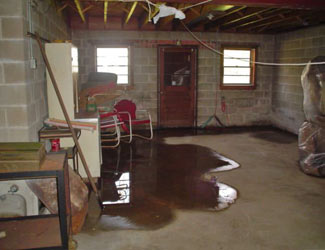 a flooded basement floor in a Baldwin home