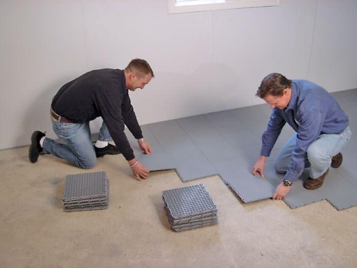 ... Contractors installing basement subfloor tiles and matting on a concrete basement floor in East Meadow & Basement Sub Floor Matting Options in Long Island | Basement ...